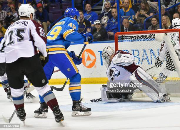Colorado Avalanche goalie Calvin Pickard knocks away a shot by St Louis Blues center Ivan Barbashev during an NHL game between the Colorado Rockies...
