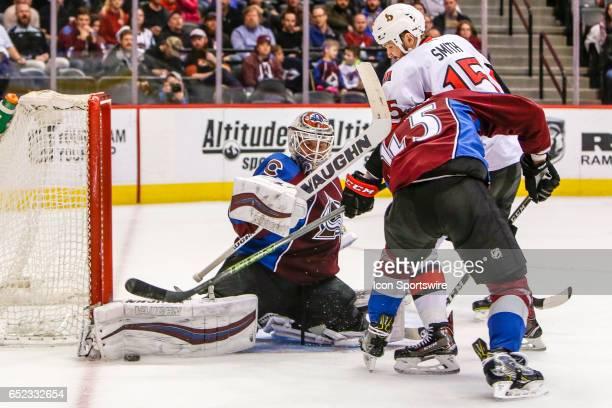 Colorado Avalanche Goalie Calvin Pickard makes save on Ottawa Senators Left Wing Zack Smith as Colorado Avalanche Defenseman Mark Barberio defends...