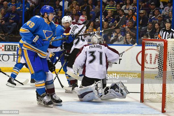 Colorado Avalanche goalie Calvin Pickard reacts as a shot by St Louis Blues center Ivan Barbashev is just wide of the goal during an NHL game between...