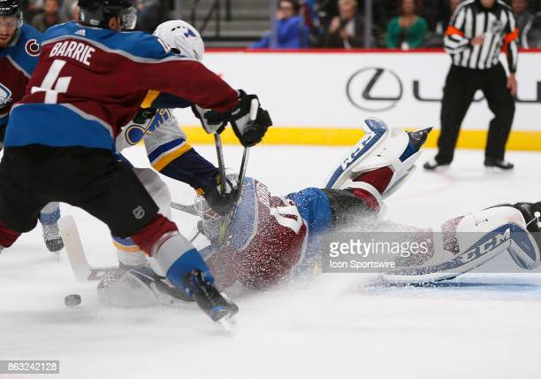 Colorado Avalanche goalie Jonathan Bernier dives for a loose puck in front of the net during a regular season game between the Colorado Avalanche and...