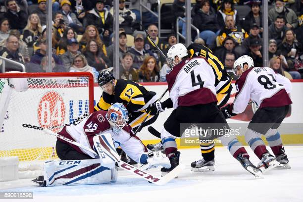 Colorado Avalanche Goalie Jonathan Bernier makes a save on Pittsburgh Penguins Right Wing Bryan Rust in front as Pittsburgh Penguins Defenseman...