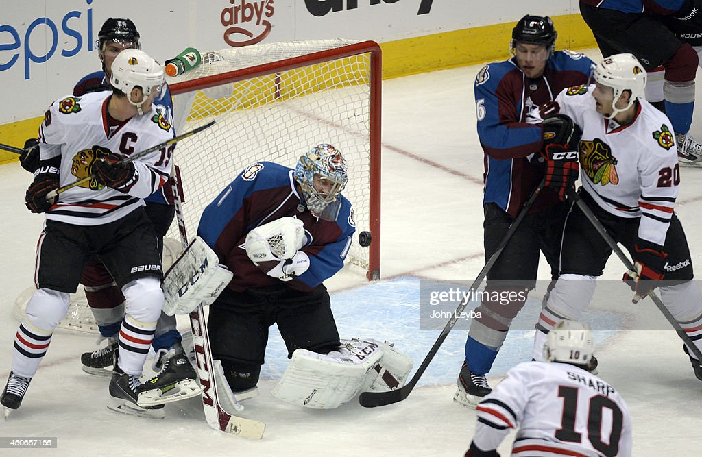 Colorado Avalanche goalie Semyon Varlamov (1) makes a save on a shot by Chicago Blackhawks left wing Patrick Sharp (10) during the second period November 19, 2013 at Pepsi Center.