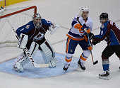 Colorado Avalanche goalie Semyon Varlamov protects his net while Colorado Avalanche center Matt Duchene battles with New York Islanders left wing...