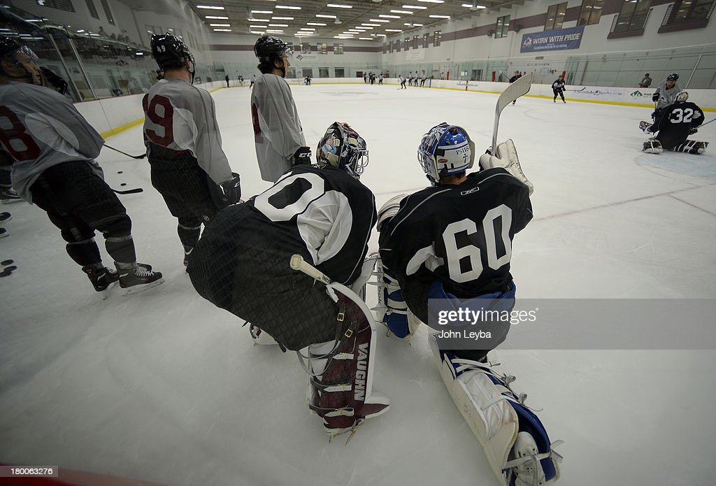 Colorado Avalanche goalies Sami Aittokallio (30 and Spencer Martin (60) chat during a a break in practice. No. 1 draft pick Nathan MacKinnon took the ice on the first day of Avalanche rookie camp September 8, 2013 at Family Sports.