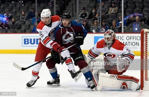 Colorado Avalanche left wing Blake Comeau fights for position with Carolina Hurricanes defenseman Brett Pesce in from of Carolina Hurricanes goalie...