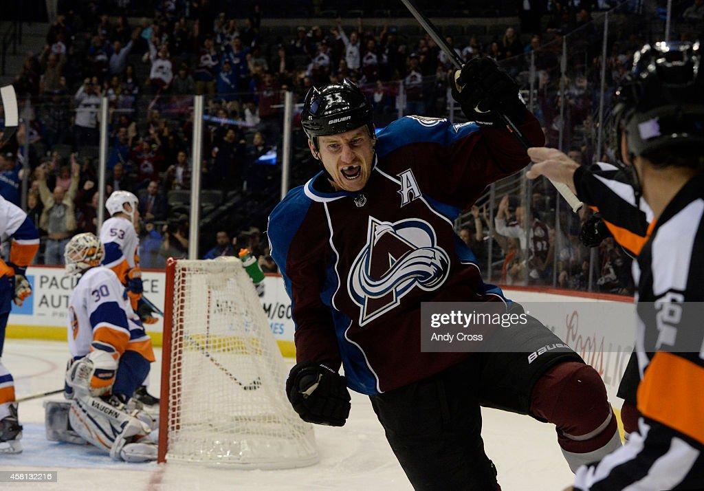 Colorado Avalanche left wing Cody McLeod celebrates his first period score against New York Islanders goalie Chad Johnson at the pepsi Center...