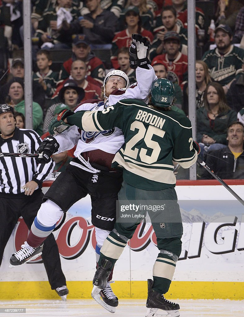 Colorado Avalanche left wing Gabriel Landeskog (92) gets pushed by Minnesota Wild defenseman Jonas Brodin (25) during the first period April 28, 2014 in Game 6 of the Stanley Cup Playoffs at Xcel Energy Center.