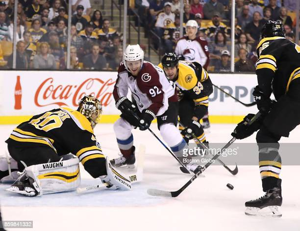 Colorado Avalanche left wing Gabriel Landeskog is pressured by Boston Bruins defenseman Zdeno Chara as teammate Tuukka Rask makes the save during the...