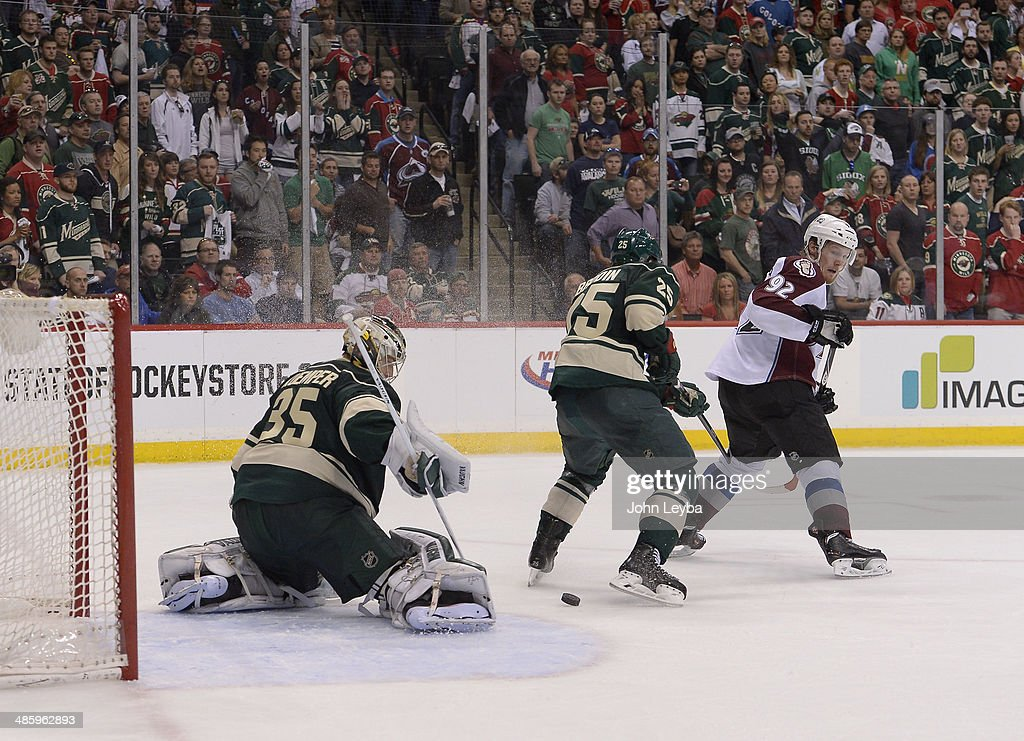 Colorado Avalanche left wing Gabriel Landeskog (92) looks back at a shot on Minnesota Wild goalie Darcy Kuemper (35) during the third period as Minnesota Wild defenseman Jonas Brodin (25) defends on the play April 21, 2014 during round 1 game three of the Stanley Cup Playoffs at Xcel Energy Center.