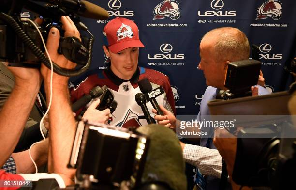 Colorado Avalanche number one pick in the 2017 NHL draft Cale Makar surrounded by media in the locker room on June 26 2017 in Denver Colorado at...