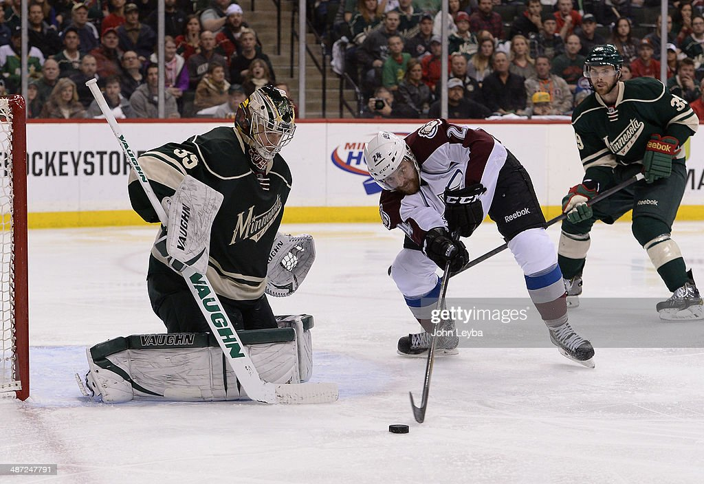 Colorado Avalanche right wing Marc-Andre Cliche (24) tries to get to a rebound as Minnesota Wild goalie Darcy Kuemper (35) makes a save on a shot during the third period April 28, 2014 in Game 6 of the Stanley Cup Playoffs at Xcel Energy Center.