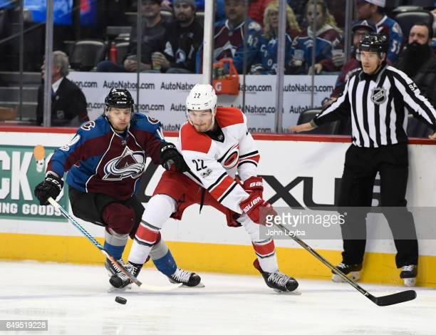 Colorado Avalanche right wing Sven Andrighetto and Carolina Hurricanes defenseman Brett Pesce chase downs he puck during the first period March 7...