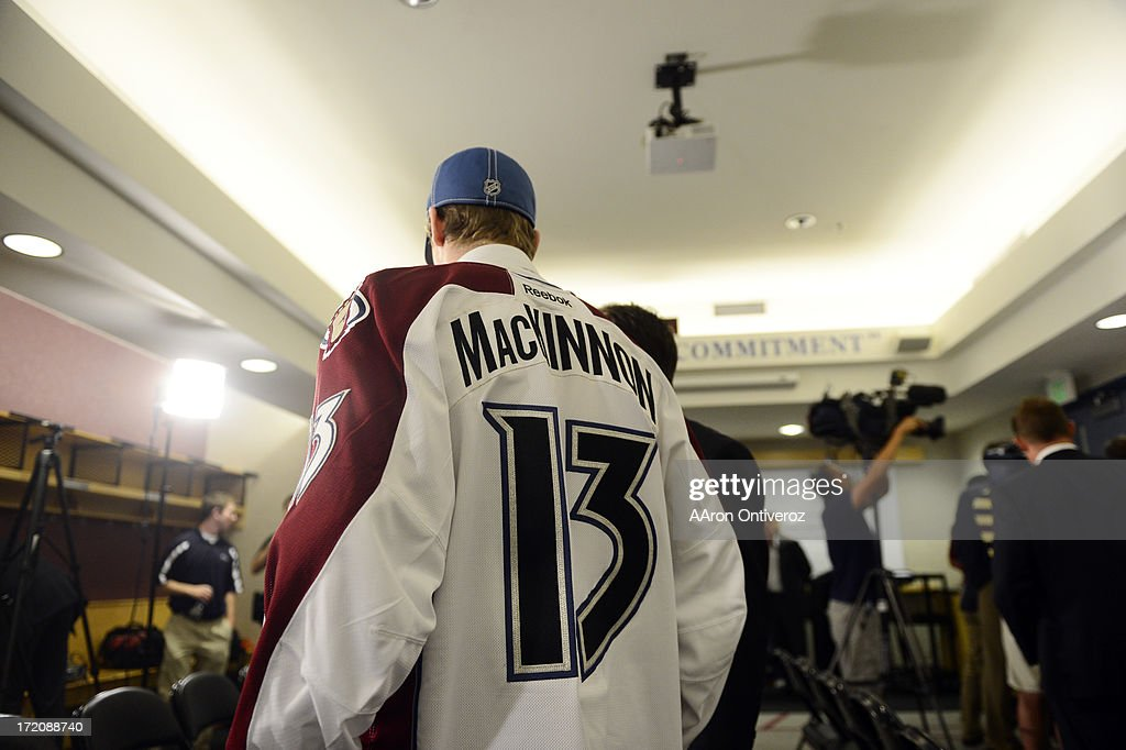 Colorado Avalanche rookie Nathan ManKinnon is welcomed by the media during a press conference for the number one overall pick in the 2013 NHL draft. MacKinnon, a native of Nova Scotia, addressed the media at the Pepsi Center.