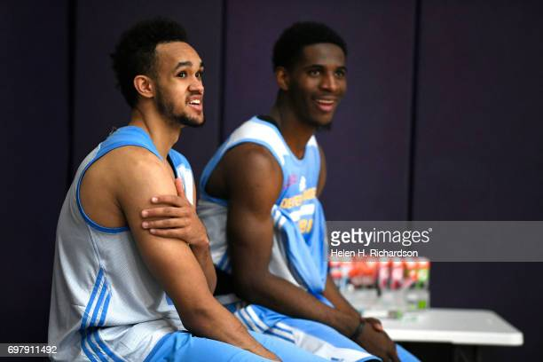 Colorado basketball standout Derrick White left sitting with fellow NBA Damyean Dotson right take part in a predraft workout with the Denver Nuggets...