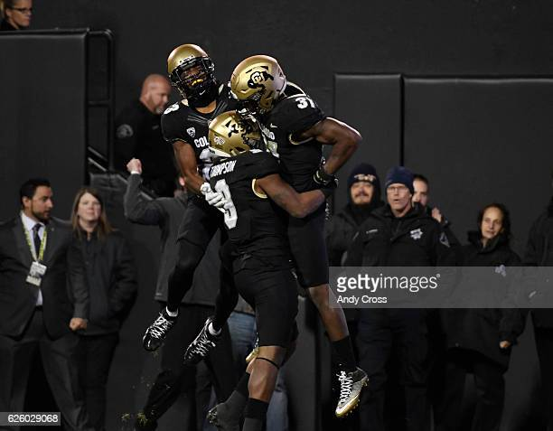 Colorado Buffaloes linebacker Kenneth Olugbode celebrates his fumble recovery for a touchdown against the Utah Utes with teammates Colorado Buffaloes...
