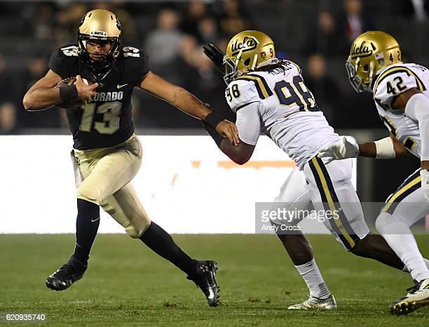 Colorado Buffaloes quarterback Sefo Liufau escapes UCLA Bruins defensive lineman Takkarist McKinley and UCLA Bruins linebacker Kenny Young in the...