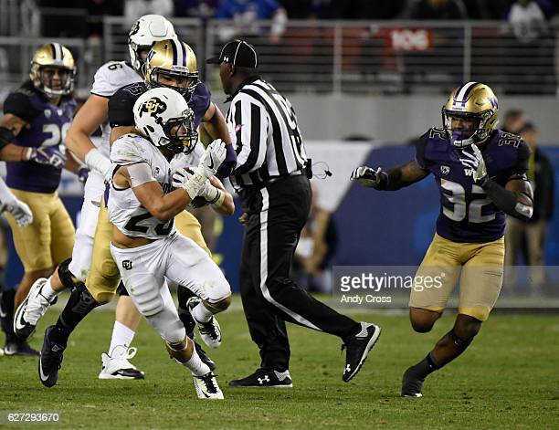 Colorado Buffaloes running back Phillip Lindsay gains yardage against Washington Huskies defensive back Budda Baker in the third quarter during the...