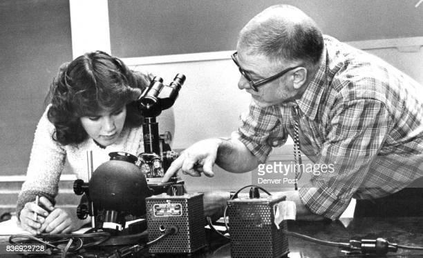 Colorado Chemistry Teacher of the Year Nicholas LeMieux shows Northglenn High School senior Wendy Joyce use of microscope Credit The Denver Post