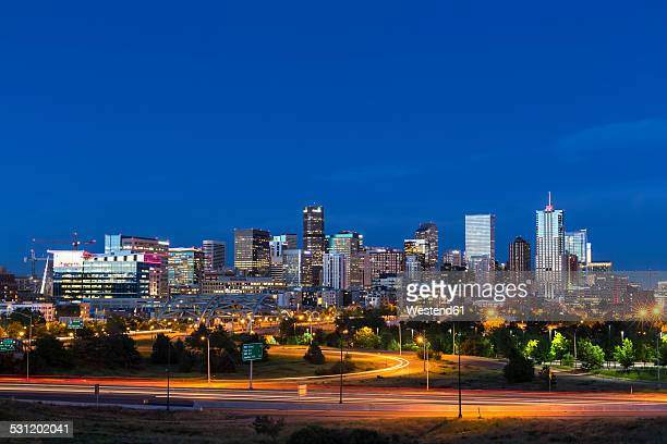 USA, Colorado, Denver, Cityscape and Interstate Highway in the evening