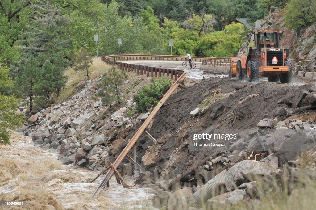 Colorado Dept of Transportation works to clear debris from Boulder Canyon, flooded due to heavy rains and swollen rivers on September 13, 2013 in Boulder, Colorado. The historic flooding forced thousands to evacuate the area and more rain is predicted through the weekend.