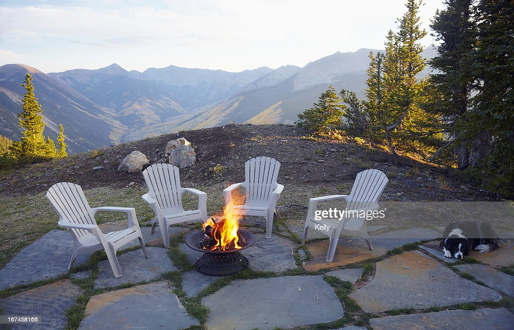 The Range Fire Pit Part - 18: USA, Colorado, Dog Lying Down By Fire Pit And Four Empty Chairs : Stock