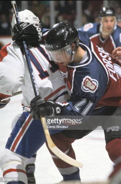 Colorado forward Peter Forsberg battles Canadiens player Saku Koivu for position in a game at the Montreal Forum during the 199596 season