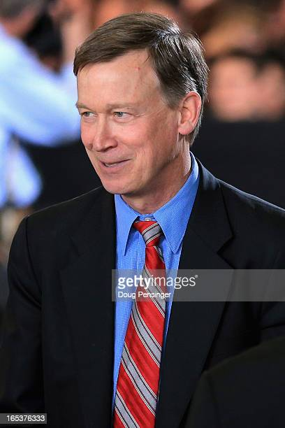 Colorado Gov John Hickenlooper attends a speech by US President Barack Obama addressing gun control issues at the Denver Police Academy on April 3...