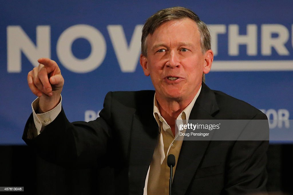 Colorado Gov. <a gi-track='captionPersonalityLinkClicked' href=/galleries/search?phrase=John+Hickenlooper&family=editorial&specificpeople=4104050 ng-click='$event.stopPropagation()'>John Hickenlooper</a> speaks to supports at a rally on October 21, 2014 in Aurora, Colorado. Hickenlooper along with former Secretary of State Hillary Clinton, U.S. Sen. Mark Udall (D-CO), U.S. Sen. Michael Bennet (D-CO) and Democratic candidate for U.S. Rep. Andrew Romanoff attended the rally for U.S. Sen. Mark Udall (D-CO) ahead of the November 4, 2014 elections.