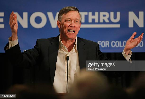 Colorado Gov John Hickenlooper speaks to supports at a rally on October 21 2014 in Aurora Colorado Hickenlooper along with former Secretary of State...