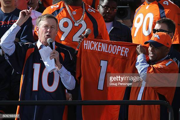 Colorado Governor John Hickenlooper and Denver Mayor Michael Hancock display the jersey that North Carolina Gov Pat McCrory will wear as part of...