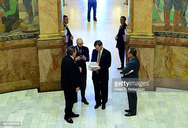 Colorado Governor John Hickenlooper gets prepared before heading up the stairs in the state capitol to the House chambers where he will give his...