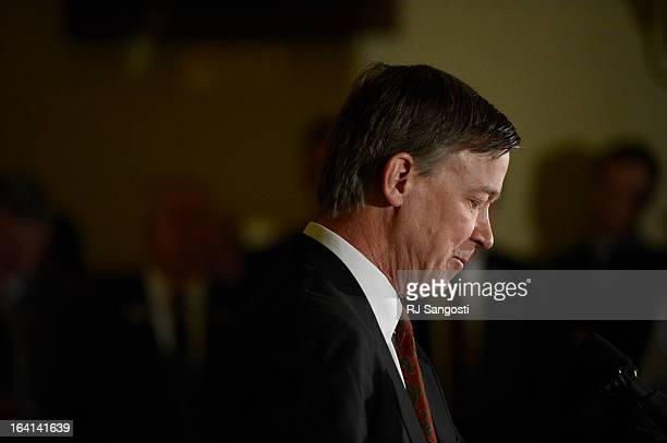 Colorado Governor John Hickenlooper holds a press conference at the State House in Denver Colorado on March 20 2013 to discuss the death of Tom...