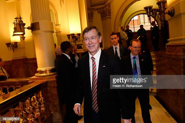 Colorado Governor John Hickenlooper leaves the House chambers after giving his State of the State address inside the House chambers of the State...
