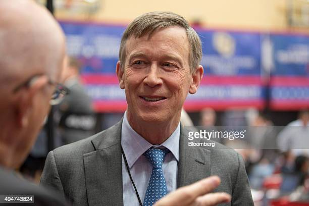 Colorado Governor John Hickenlooper speaks with attendees in the spin room during the first Republican presidential debate at the University of...