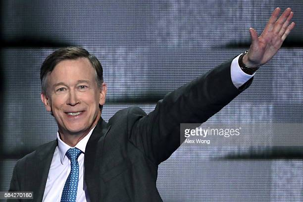 Colorado Governor John Hickenlooper waves to the crowd as he arrives on stage to deliver remarks on the fourth day of the Democratic National...