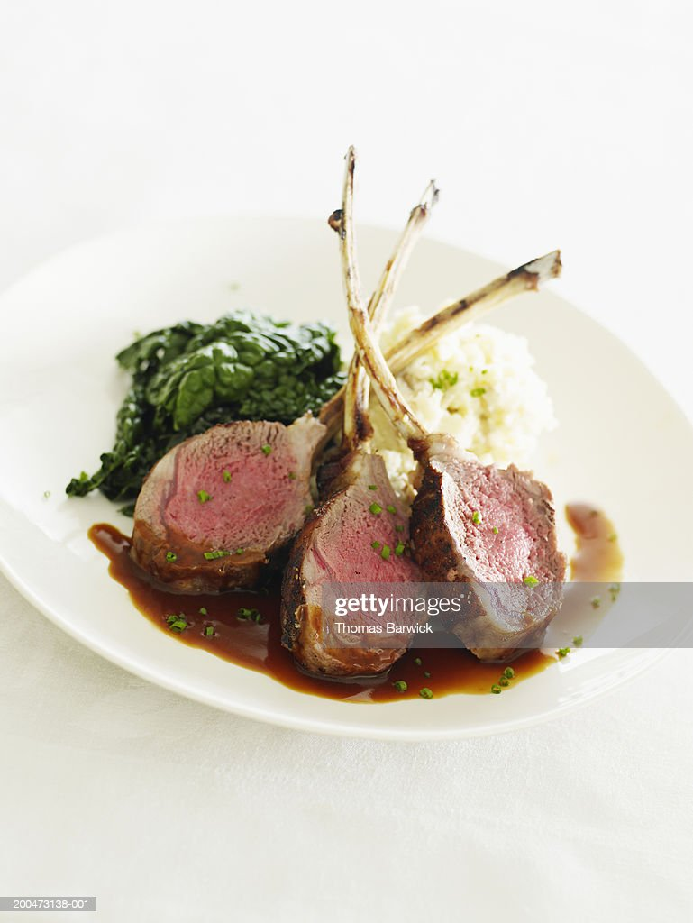 Colorado lamb with kale, mashed potatoes and mint demi-glace : Stock Photo