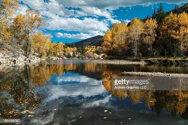 Colorado mountain river reflection in autumn