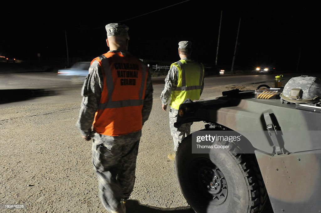 Colorado National Guard personnel divert traffic from flooded roads September 17, 2013 near Johnstown, Colorado. Even as flooding subsides, many in the hardest hit areas of the state remain stranded by washed out roads and rushing creeks and without water and power.