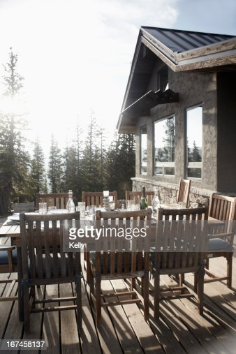 USA, Colorado, Outdoor table and chairs in front of house : Stock Photo