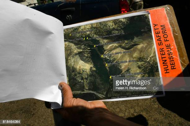 Colorado Parks Wildlife Aquatic Biologist Boyd Wright shows on a map the 5 locations to release the Greenback Cutthroat trout along Herman Gulch on...