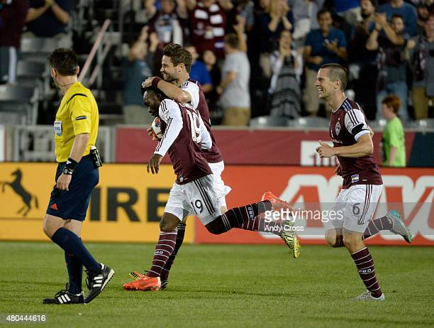 Colorado Rapids defender Drew Moor second from left celebrates with teammate Colorado Rapids forward Charles Eloundou after Moor scored a goal...
