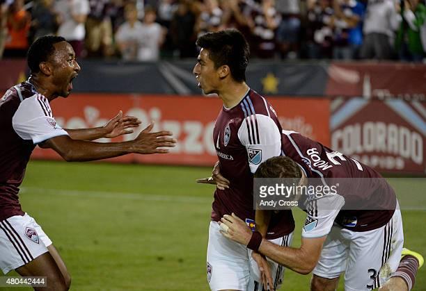 Colorado Rapids defender James Riley left and Colorado Rapids defender Drew Moor right tackle Colorado Rapids midfielder Juan Ramirez after Ramirez...