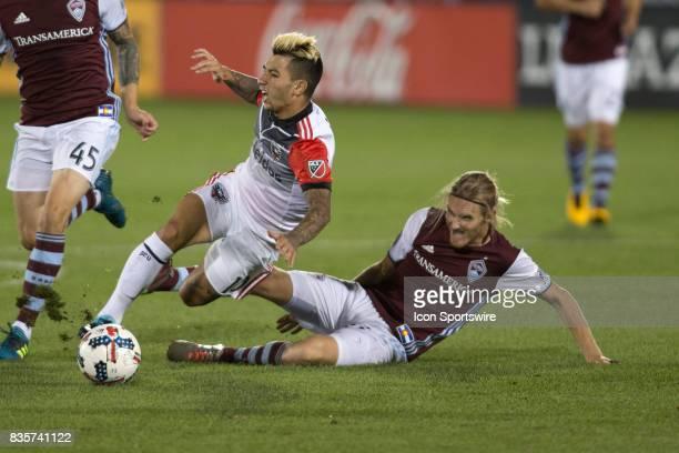 Colorado Rapids defender Jared Watts slide tackles DC United midfielder Luciano Acosta during the Colorado Rapids game vs the DC United on August 19...