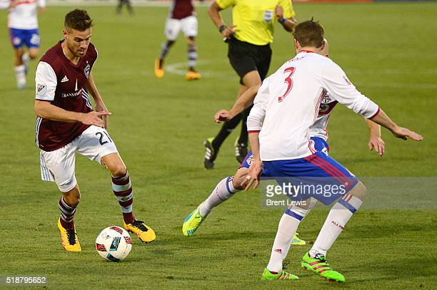 Colorado Rapids forward Luis Solignac looks for a way around Toronto FC defender Drew Moor during the second half at Dick's Sporting Goods Park on...