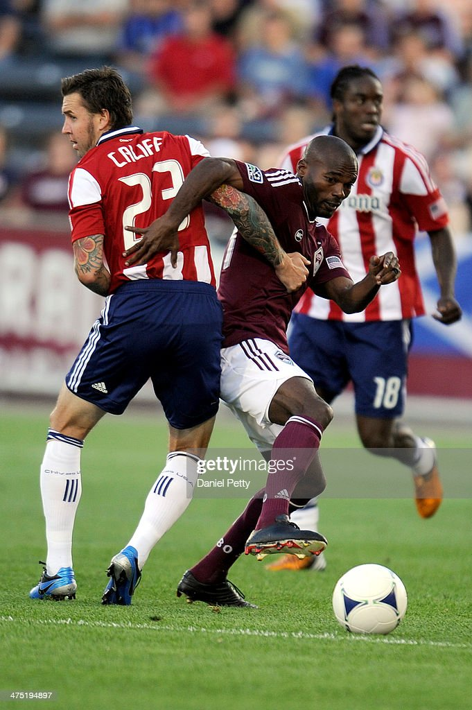 Colorado Rapids forward Omar Cummings is held by Chivas USA defenseman Danny Califf during an MLS game on August 18 in Commerce City Colorado The...