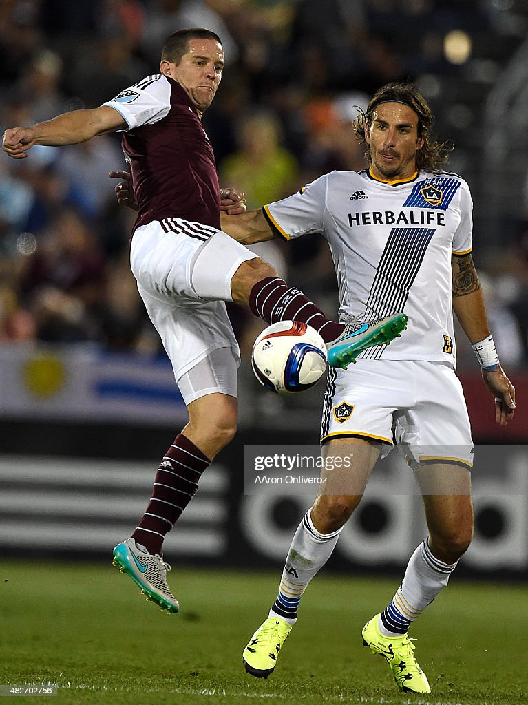 Colorado Rapids midfielder Sam Cronin (6) kicks the ball as Los Angeles Galaxy forward <a gi-track='captionPersonalityLinkClicked' href=/galleries/search?phrase=Alan+Gordon+-+Fu%C3%9Fballspieler&family=editorial&specificpeople=11667134 ng-click='$event.stopPropagation()'>Alan Gordon</a> (9) defends during the second half of the Galaxy's 3-1 win. The Colorado Rapids hosted the Los Angeles Galaxy on Saturday, August 1, 2015.