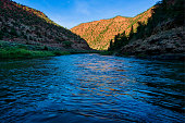 Colorado River Canyon Reflections at Sunset - Warm and cool tones reflecting in blue water.
