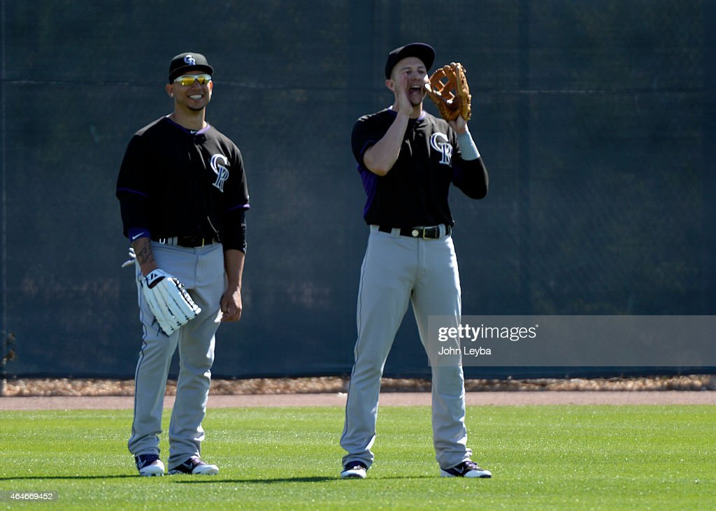 Colorado Rockies Carlos Gonzalez (5) smiles as <a gi-track='captionPersonalityLinkClicked' href=/galleries/search?phrase=Troy+Tulowitzki&family=editorial&specificpeople=757353 ng-click='$event.stopPropagation()'>Troy Tulowitzki</a> (2) yells to coach Rene Lachemann during the teams workout on day 7 of spring training February 27, 2015 in Scottsdale.
