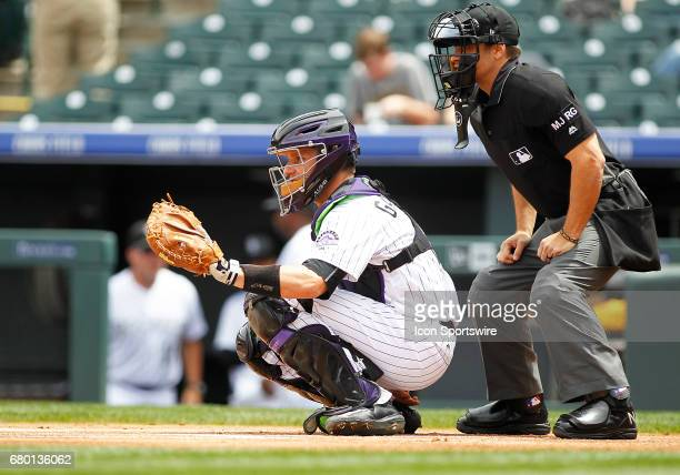Colorado Rockies Catcher Dustin Garneau and home plate umpire Mark Wegner wait for the pitch during a regular season MLB game between the Colorado...