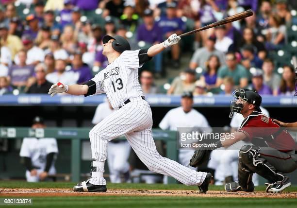 Colorado Rockies Catcher Dustin Garneau bats during a regular season MLB game between the Colorado Rockies and the visiting Arizona Diamondbacks on...